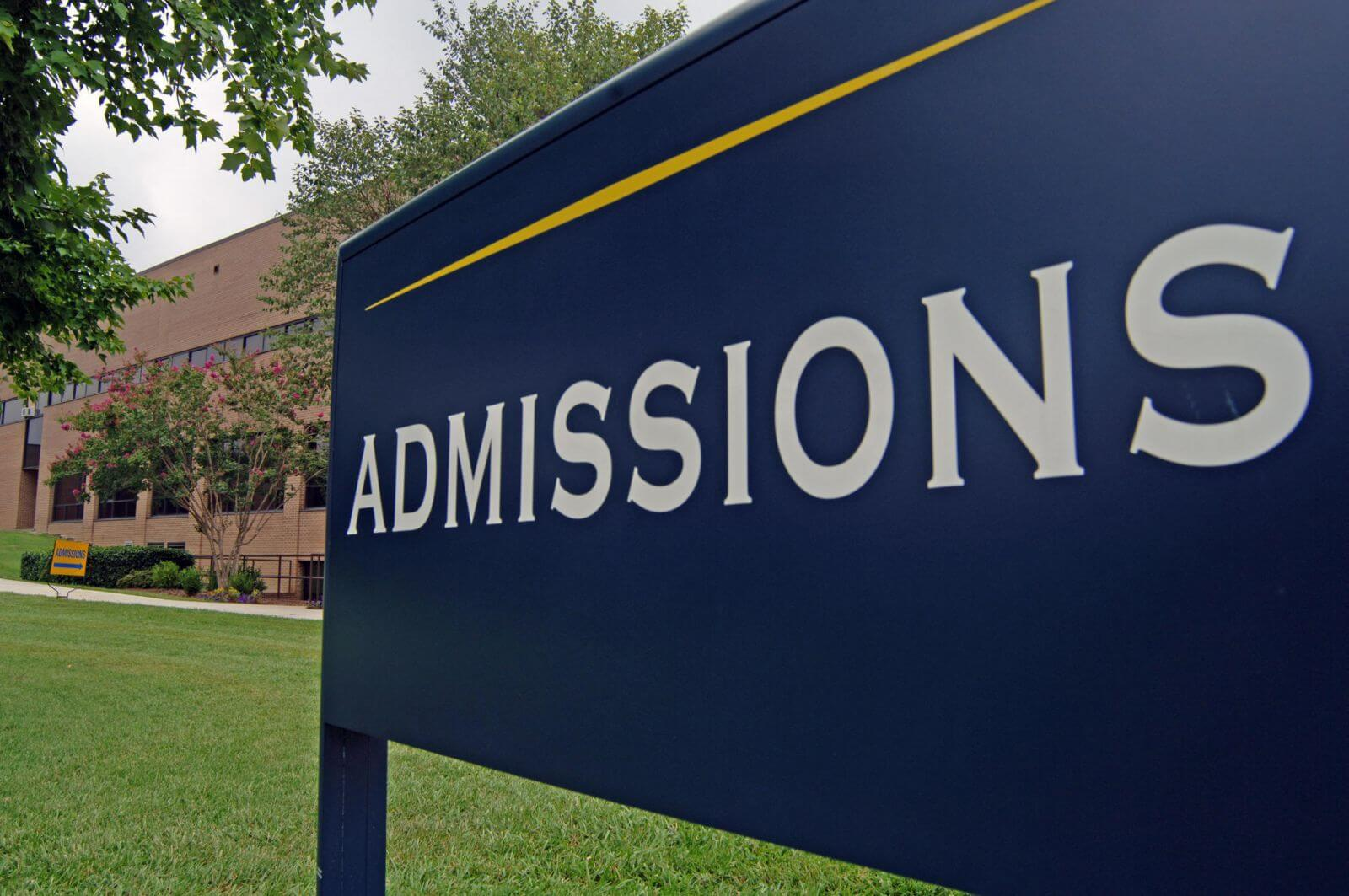 Picture of an admissions sign at a college campus, the office that is in charge of handling early admissions decisions